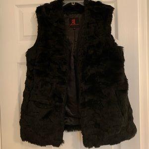 Beautiful black fur vest. Worn once